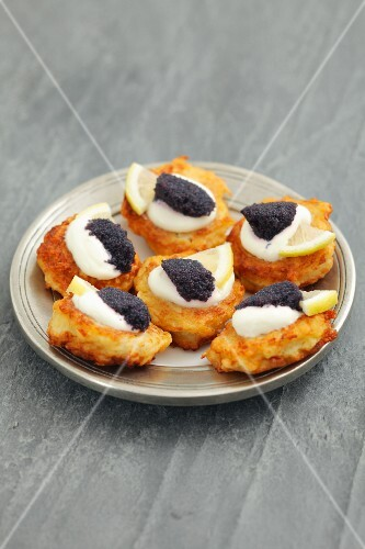 Potato fritters with caviar