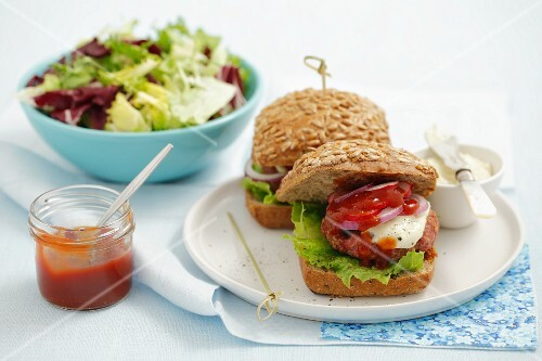 Hamburgers with tartare sauce and ketchup