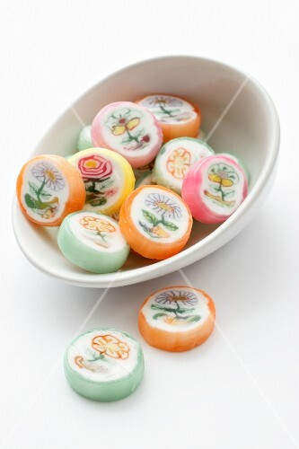 Several sweets with a flower design in a bowl