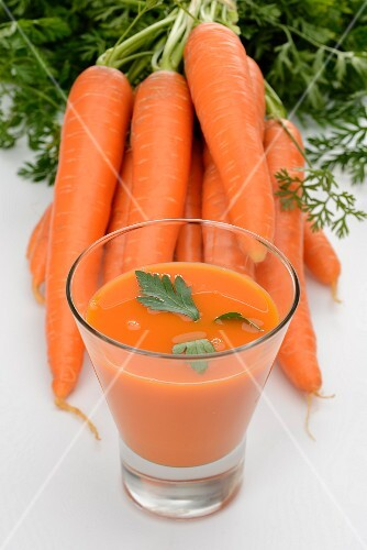 A glass of fresh carrot juice