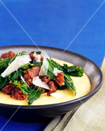 Soft Polenta Topped with Ground Pork, Kale and Shaved Parmesan Cheese