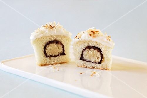 Vanilla Cupcake Stuffed with a Chocolate Covered Coconut Candy with Vanilla Frosting and Toasted Coconut