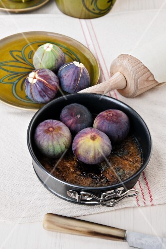 A baking tin with figs (in preparation for fig tarte tatin)