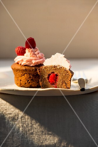 A cupcake with raspberry filling