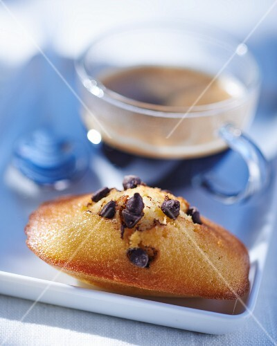 Chocolate chip madeleines with a cup of coffee