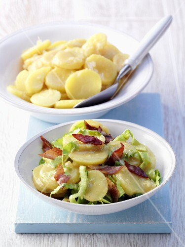 A potato salad with onions, and a potato salad with bacon strips