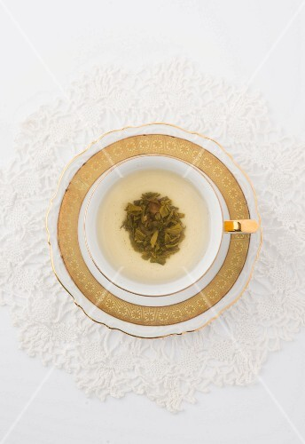 Cup of Green Tea on White