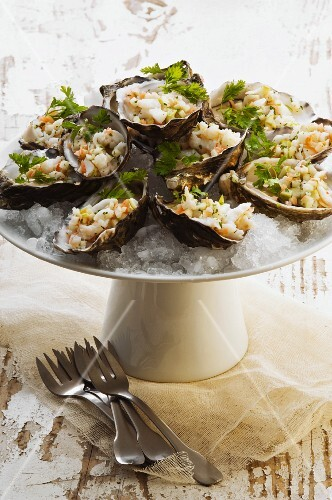 Oysters stuffed with crab, on ice