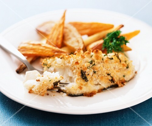 Fish fillet with a herb crust and roasted carrots and parsnips