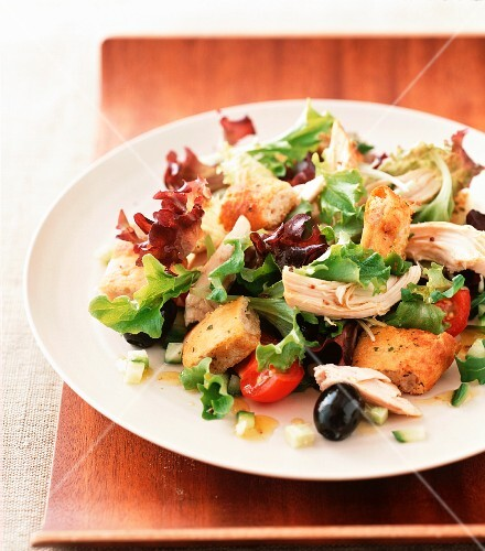 Chicken salad with herb croutons and olives