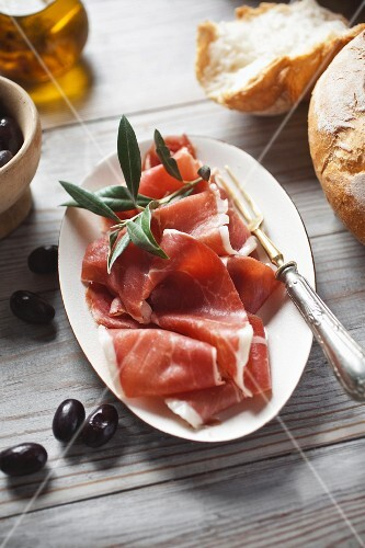 Serrano ham with bread and olives