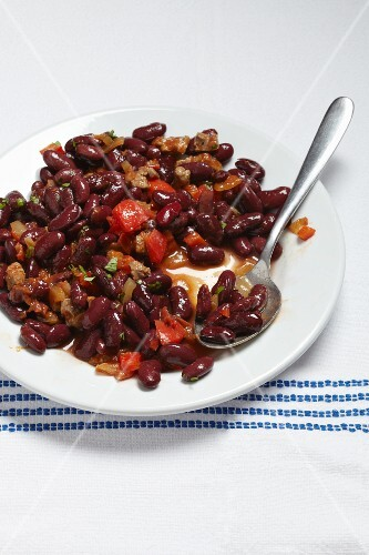 Chili con carne on a plate with a spoon