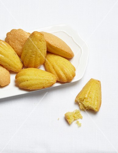 Madeleines, one with a bit taken out of it