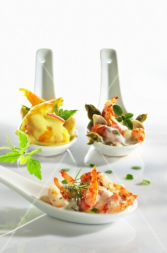 Assorted prawn cocktails on tasting spoons