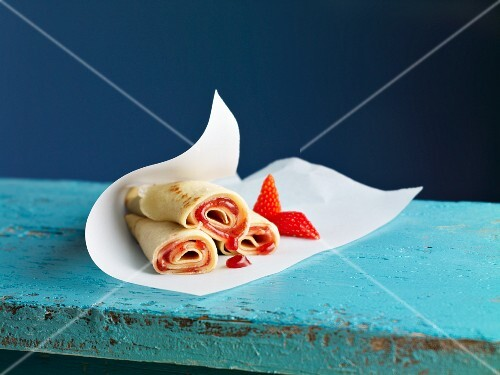 Crepe rolls filled with strawberry jam