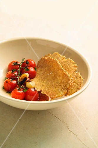 Roasted tomatoes and toasted semolina flat bread