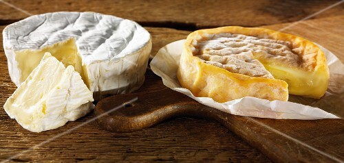 Sliced camembert on a cutting board