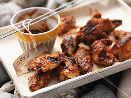 Barbecued chicken wings with barbecue sauce