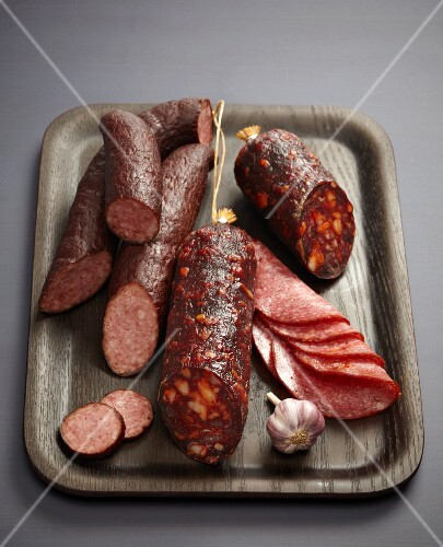 Assorted sausages and salamis on a tray