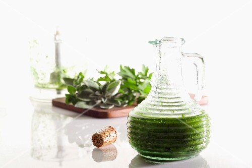 Olive oil with herbs in a jug