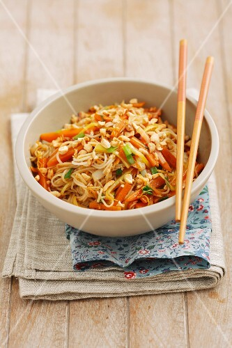Spaghetti with carrots, spring onions and pine nuts
