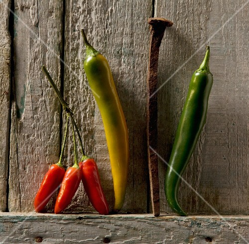 Chilli peppers and a rusty nail