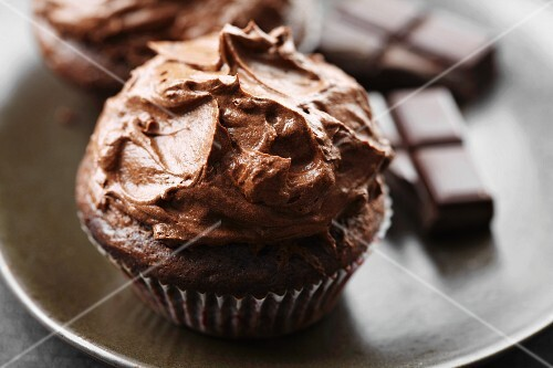A chocolate cupcake with chocolate icing