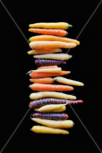 A stack of colourful root vegetables