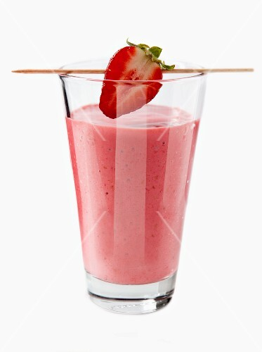 A strawberry smoothie with a strawberry on a cocktail stick