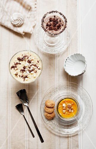 Pumpkin cream with amaretti biscuits, muscatel cream with meringue pieces, and coffee and ricotta cream with chocolate biscuit pieces