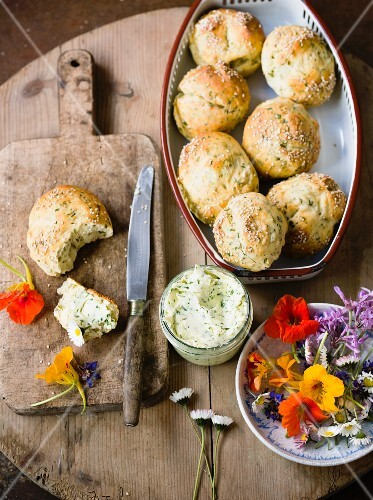 Herb rolls with herb butter and edible flowers
