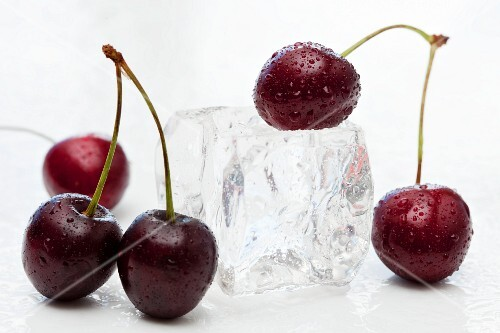 Sweet cherries and an ice cube
