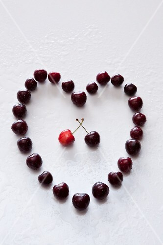 A heart made of sweet cherries