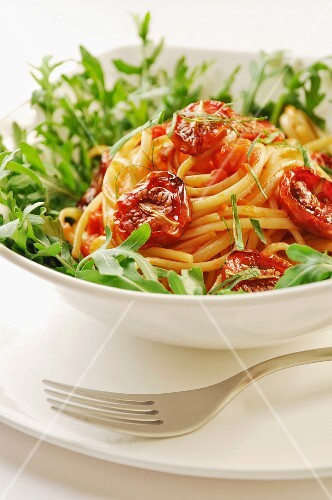 Delicious fresh pasta with balsamico marinated and dried tomatoes