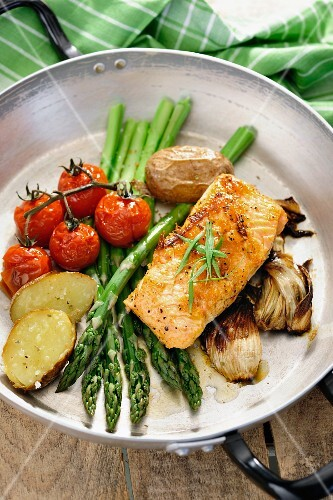 Baked vegetables and salmon in a pan