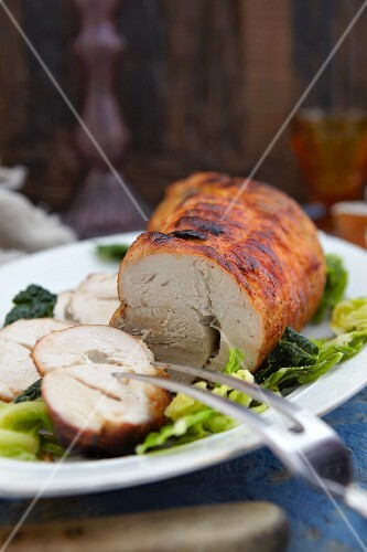 Roasted turkey joint, partly sliced, with savoy cabbage