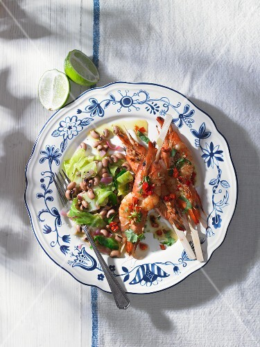 Grilled prawn skewers with a bean salad