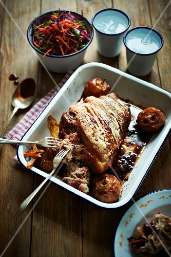 Roast pork wrapped in bacon, with apples