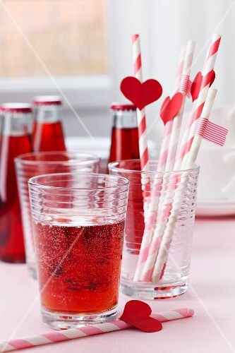 Red lemonade and straws decorated with hearts