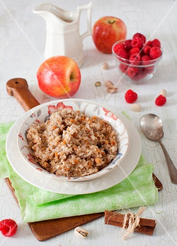 Bowl of Oatmeal with Apples, Raspberries and Cinnamon