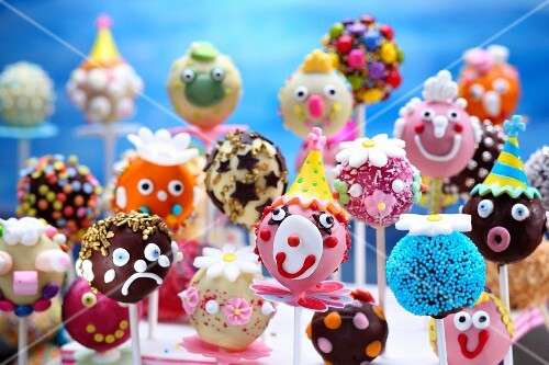 Colourful and humorously decorated cake pops