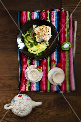 Poached fish with sesame seeds and avocado