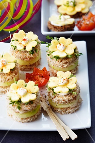 Canapes for New Year's Eve decorated with clover leaf-shaped cheese