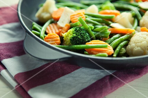 Pan-fried broccoli, cauliflower, carrots and beans