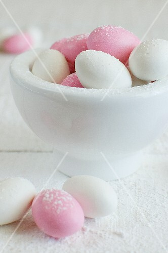 Sugar eggs in and next to a bowl