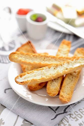 Crispy slices of bread with butter