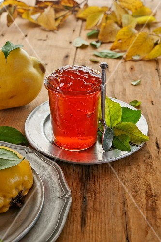 Quince jelly in a glass on a tin plate