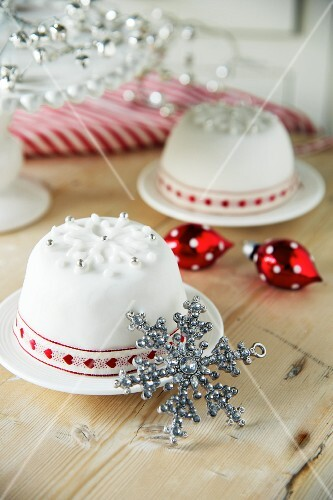 Christmas puddings covered in white icing