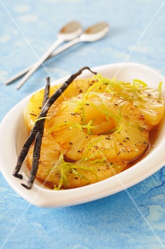 Baked pineapple slices with vanilla and lime zest