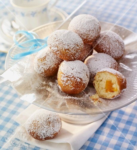 Mini doughnuts with jam filling, dusted with icing sugar